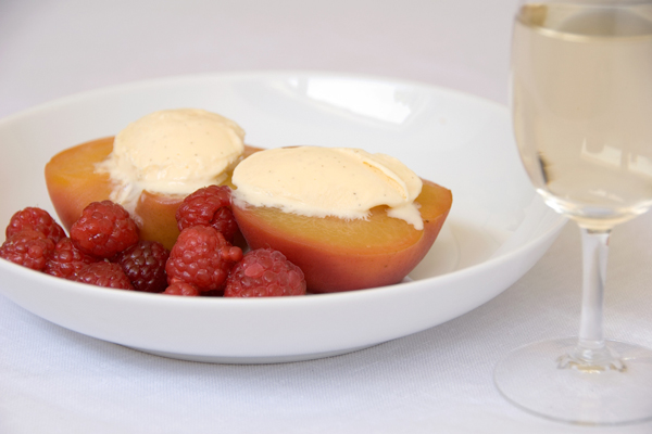 Peaches poached in white wine, with raspberries