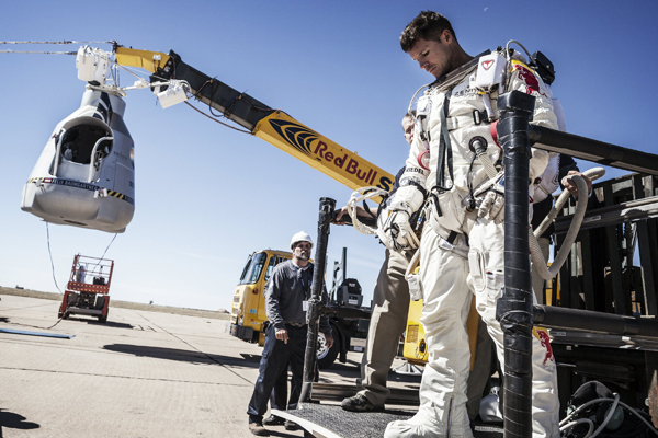 Felix Baumgartner collects his thoughts after the mission was aborted due to high winds at the site.