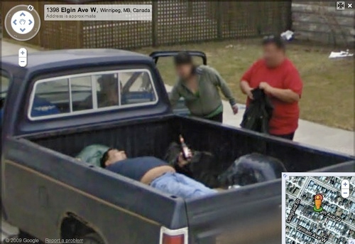 This notorious image shows a man sprawled out in the back of his ute, drinking beer.