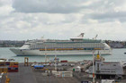 "Referred to as the ""Floating Hotel"", Voyager of the Seas heads in to Auckland Harbour. Photo: Geoff Rooke"