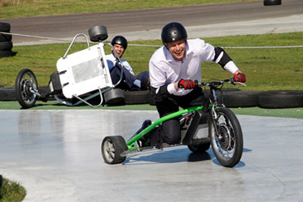 Picture: Ministers Chris Tremain and Simon Bridges battle it out on the drift trikes. Photo: ChrisTremain.co.nz