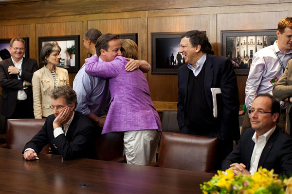 British PM David Cameron hugs Germa