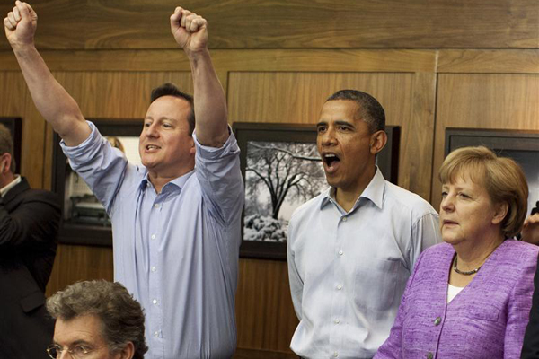 British PM David Cameronis all cheers after Didier Drogba slots home the winning penalty. Image: Reuters.