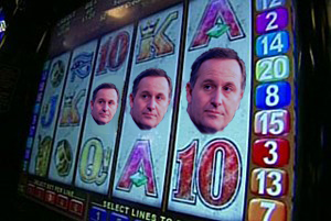John Key - pokie face