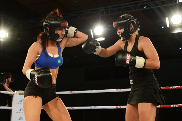 "Jamie Ridge forces Rosanna Arkle back during the ""Battle of the Babes"" at the KFC Godfather of Fight Nights at the Sky City Grand Hotel, Auckland, New Zealand on Thursday 5 July 2012. Ridge won the fight on points. Photo: Andrew Cornaga/Photosport.co.nz"