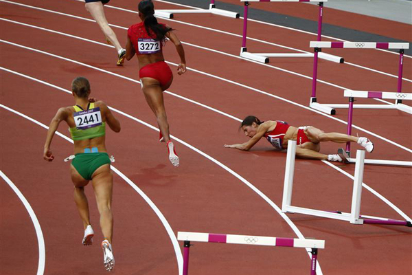A disappointed Vania Stambolova takes her landing lightly compared with her disappointment. Photo: Reuters.