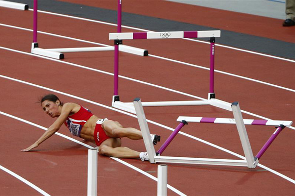 Vania Stambolova lies on the ground at the Olympic Stadium in London. Photo: Reuters