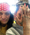 Rihanna shows off her traditional hand art - sponsored by Citroën