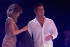Simon Cowell pelted with eggs
