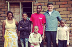 Mum, son, daughter, dad Lucas, daughter and Rhys Darby. Lucas received a small loan from World Vision that helped him start a petrol and bike repair business in Magugu ADP in Tanzania.