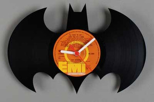 You could make this clock by using a hot wire cutter to make the bat shape